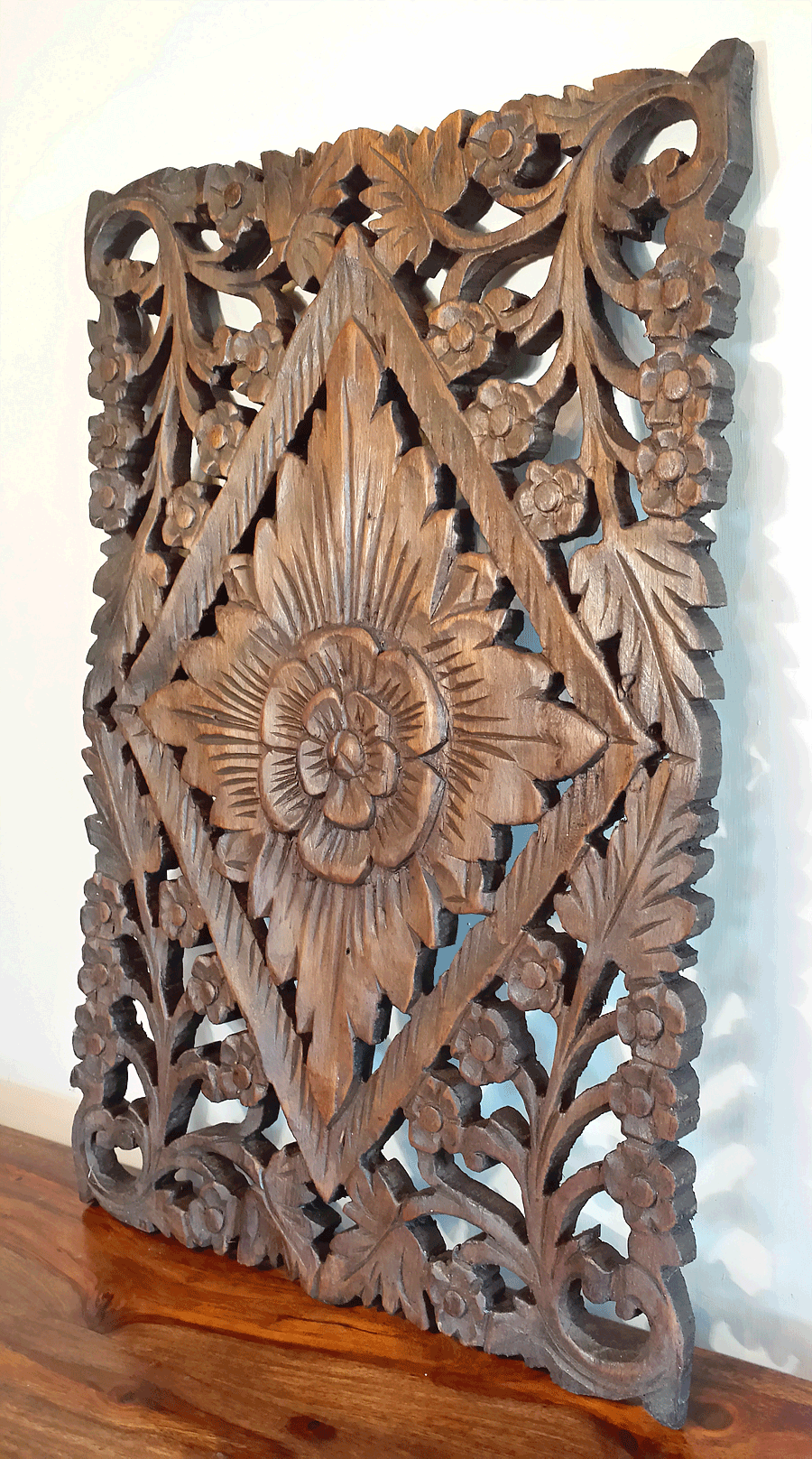 Hand carved teak wood waxed floral wall panel