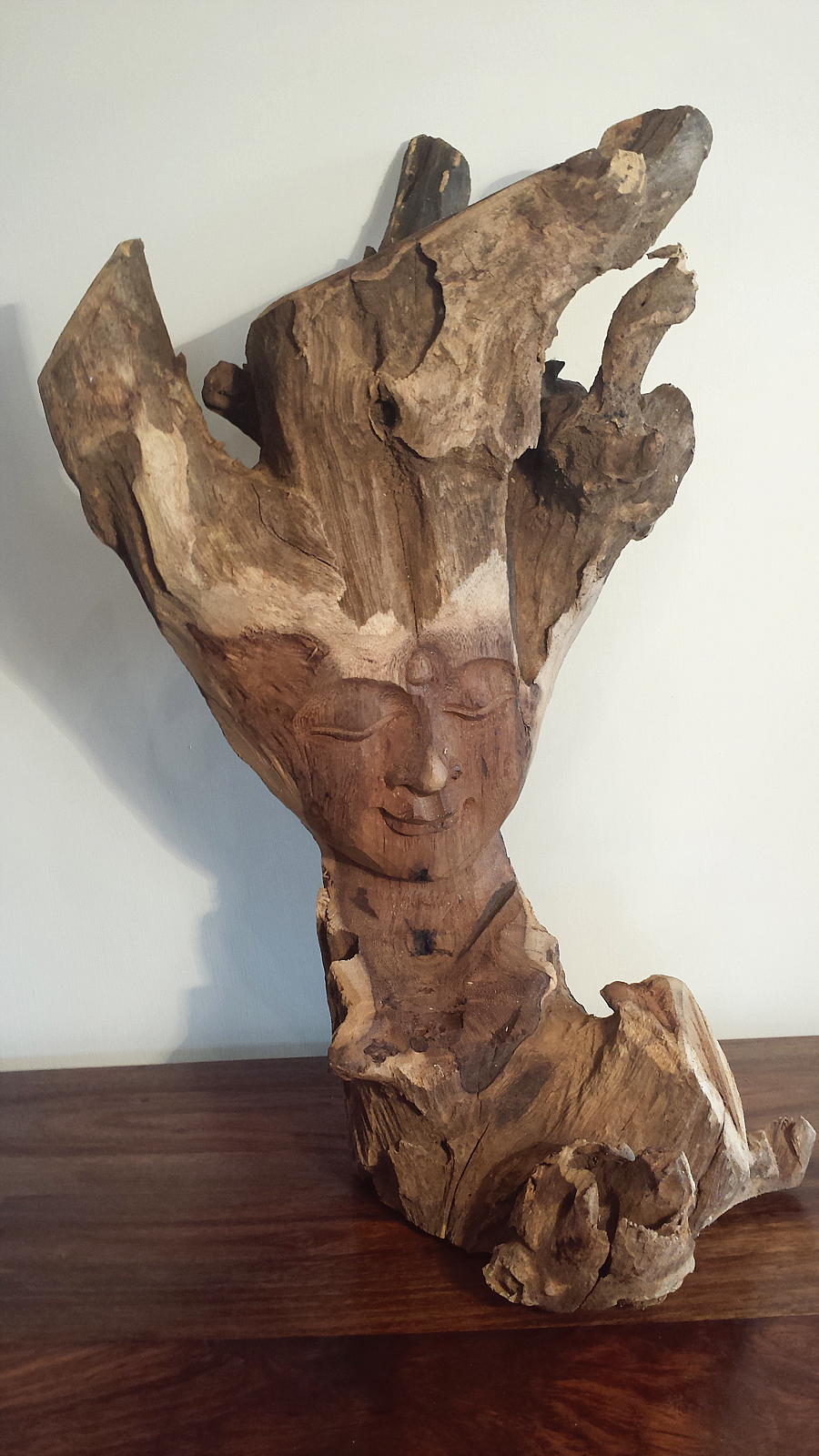 Hand carved driftwood buddha
