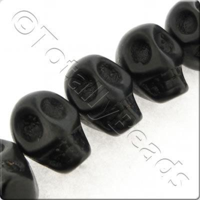 Synthetic Turquoise Skulls 15mm - Side Drilled Black