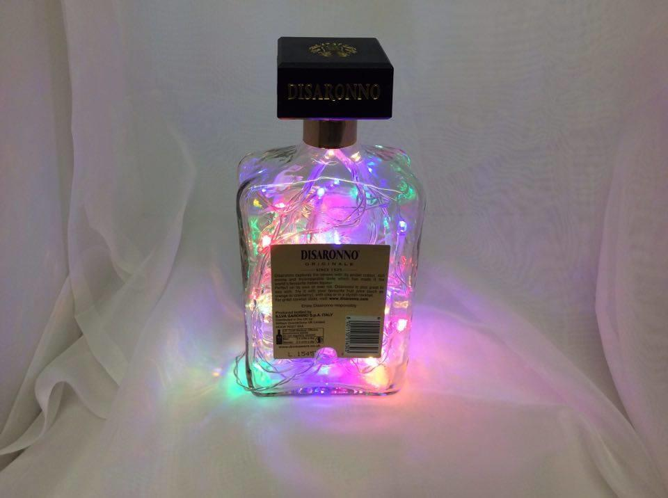 Decorated Disaronno Bottle With Coloured Lights Dcl