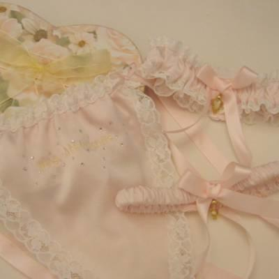 a58d93807 Delightful wedding and honeymoon ranges of lingerie are available to order.  Pictured is a blush pink garter set with a matching thong.
