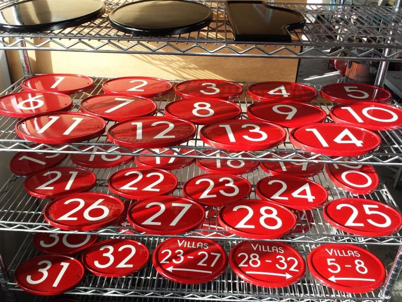 oval house signs with numbers and directional arrows ready for dispatch